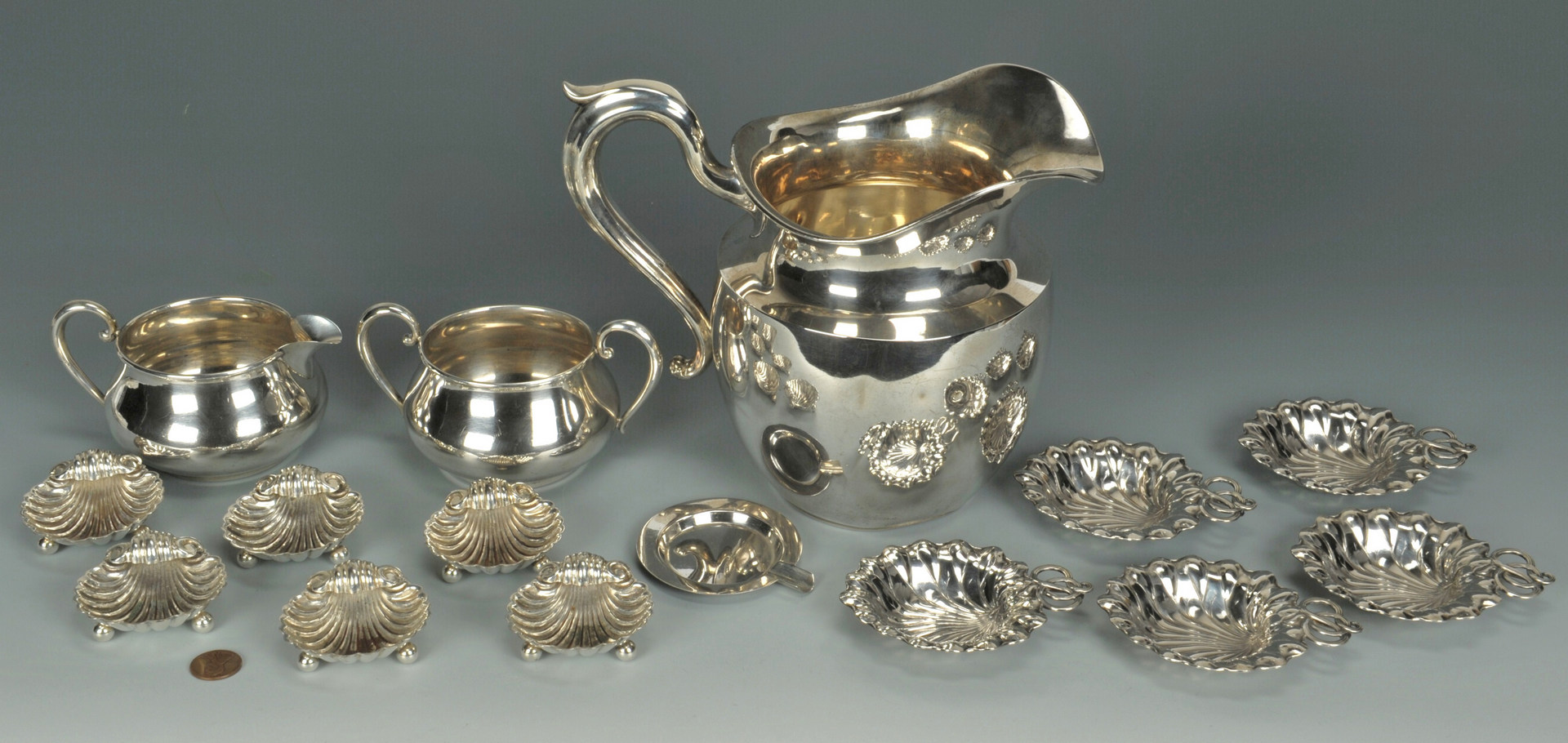Lot 426: Sterling pitcher, creamer, sugar, small nut bowls