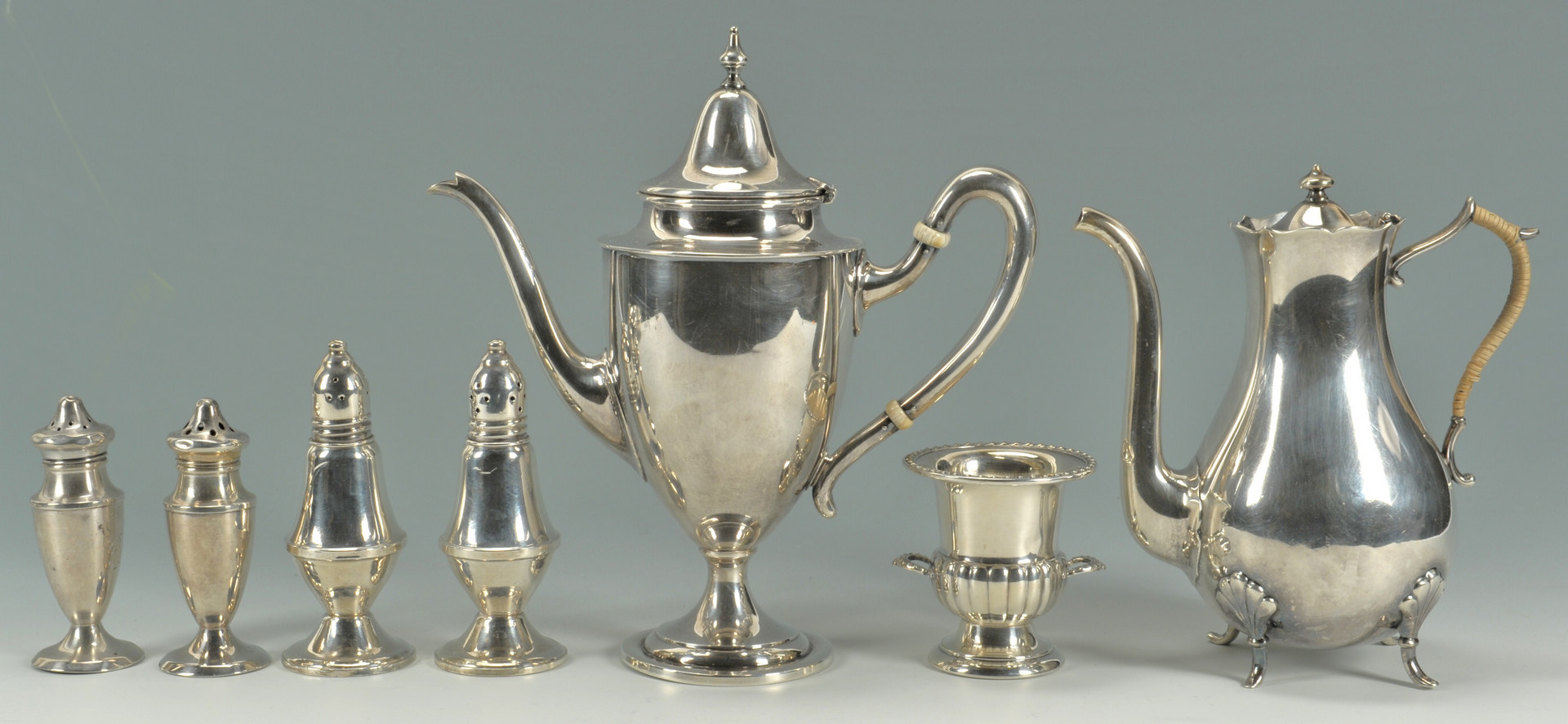 Lot 428: 7 items assorted silver hollowware inc. teapots
