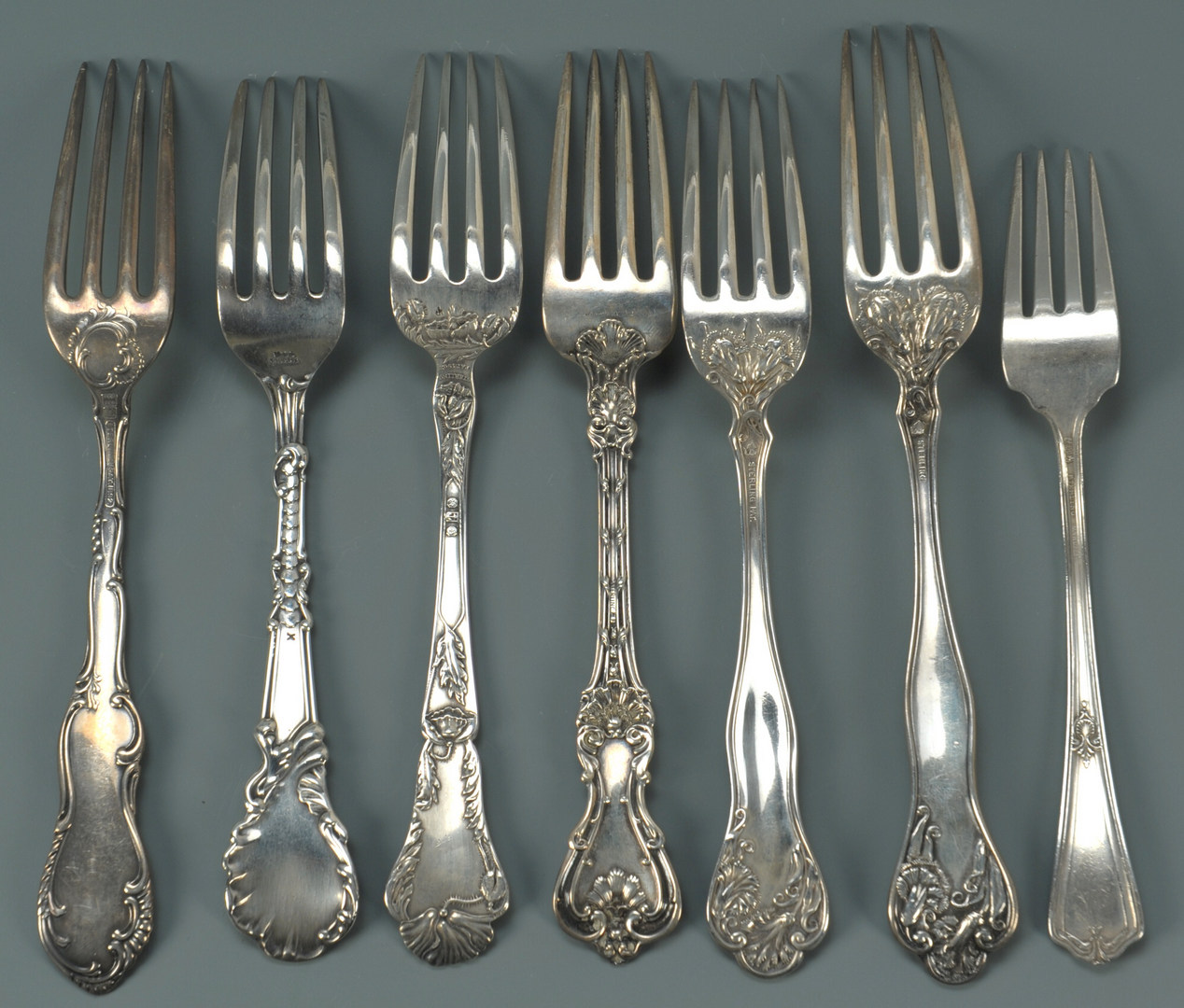 Lot 430: 38 pcs assorted sterling flatware, early patterns