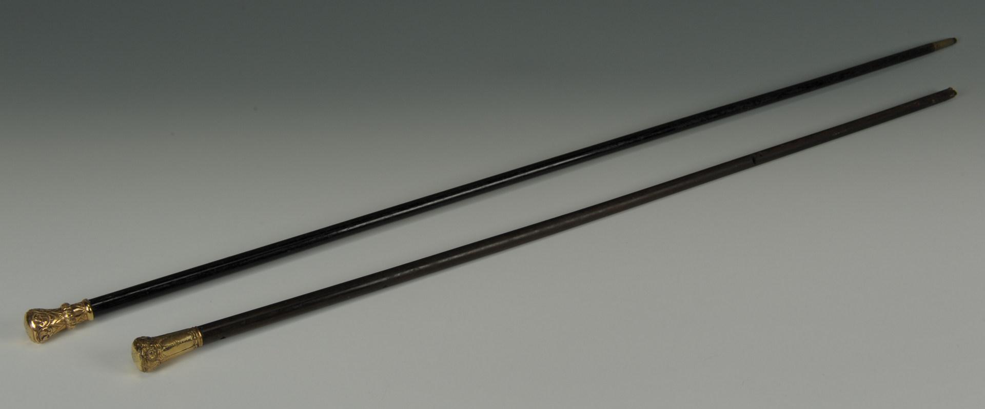 Lot 512: Two gold handled walking sticks, 19th c.