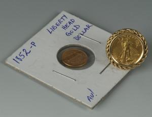Lot 544: 14K Liberty 5 Dollar ring and Liberty dollar