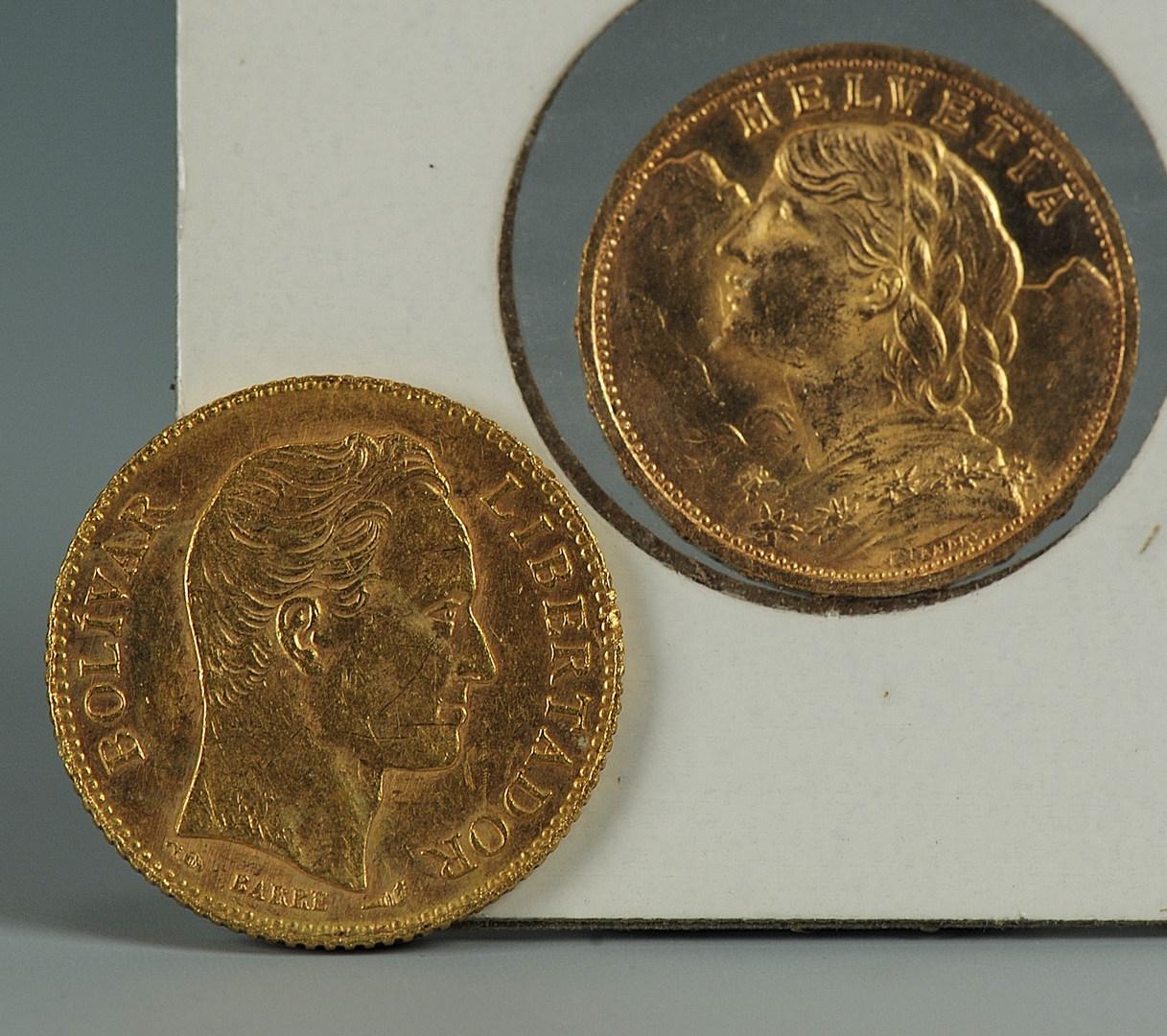 Lot 545: 2 gold coins: 1927 Swiss 20 FR; 1904 20 Bolivar