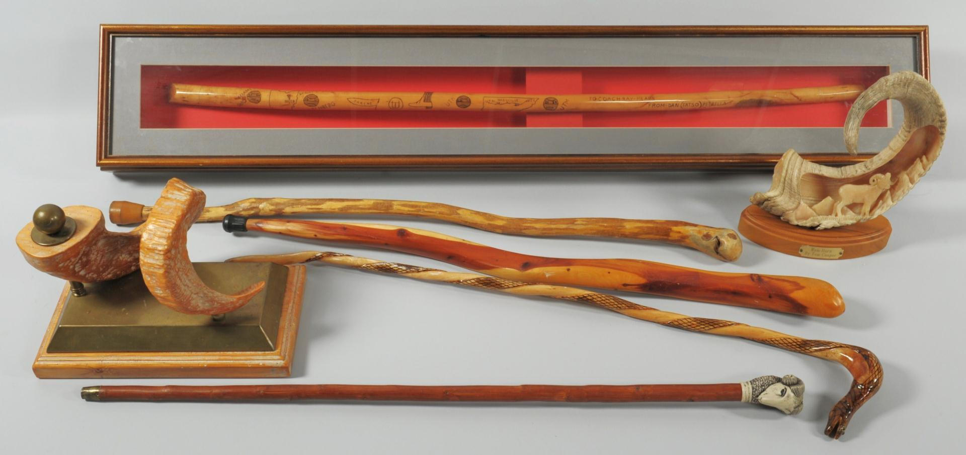 Lot 605: Grouping of Ray Mears decorative items. 2 ram horn