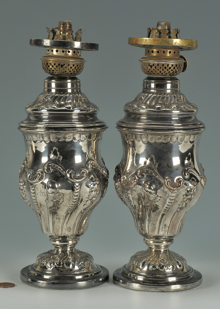 Lot 621: Pair Silver over Copper Oil Lamps