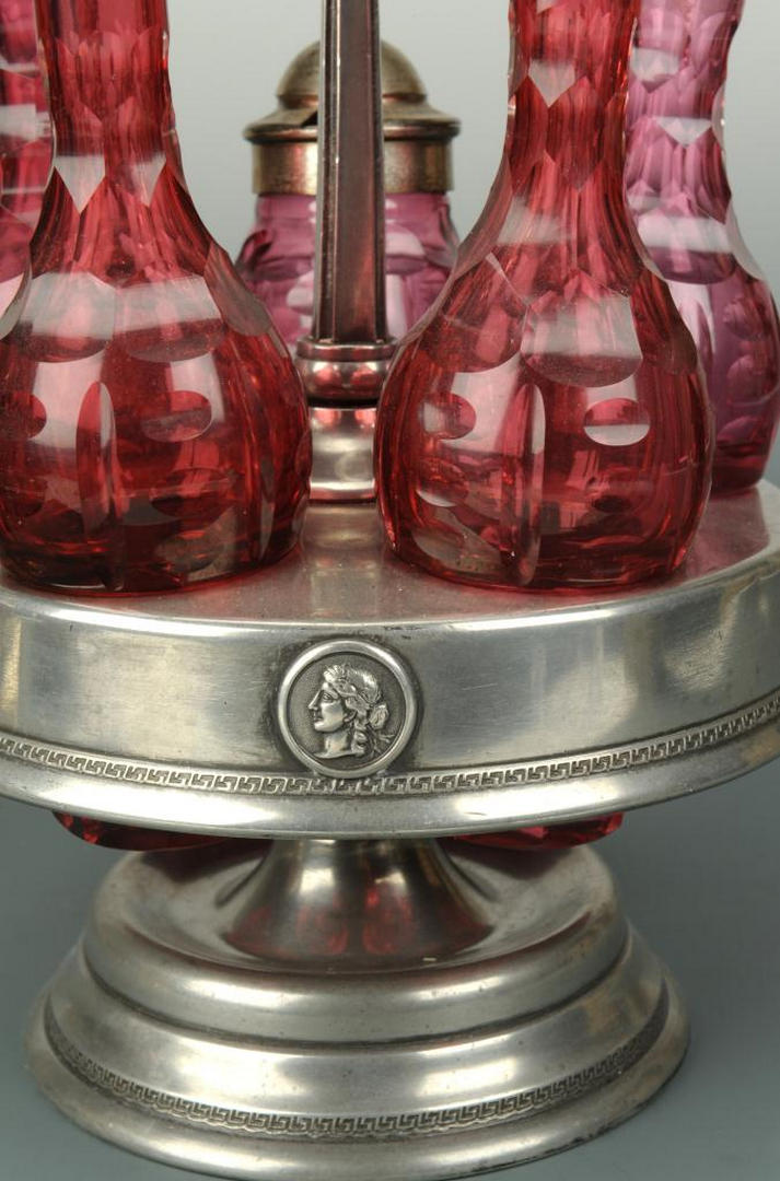 Lot 627: Victorian pickle caster and 5-pc cruet set