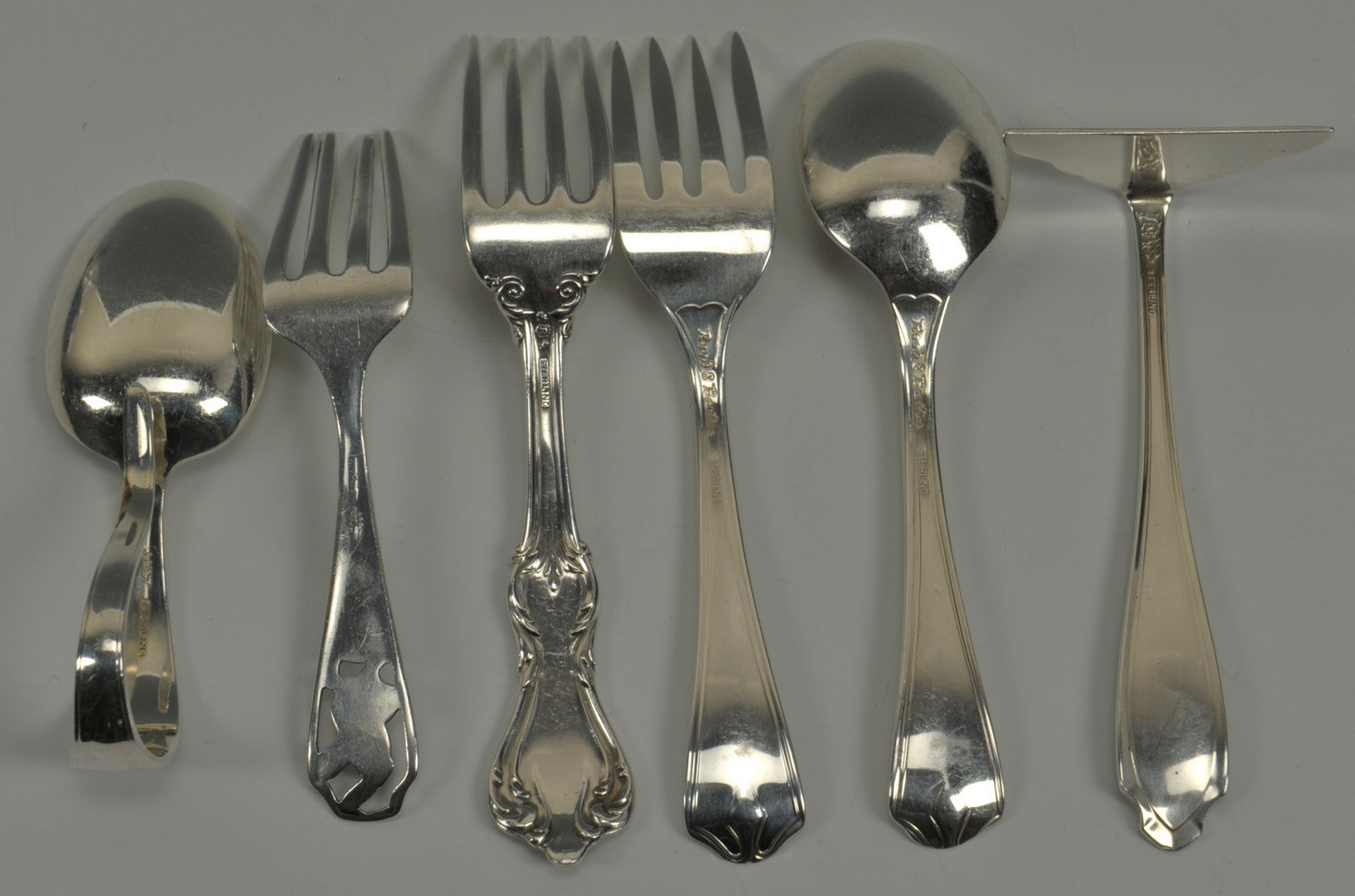 Lot 632: Group of Sterling baby and child items