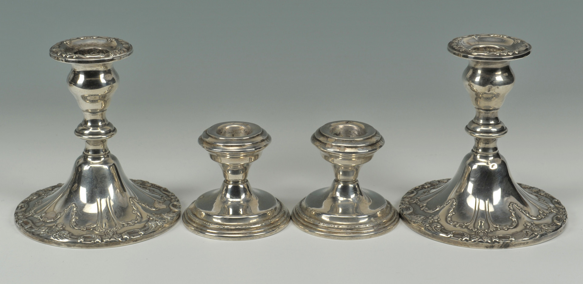 Lot 633: 8 pieces of sterling hollowware (7 weighted)