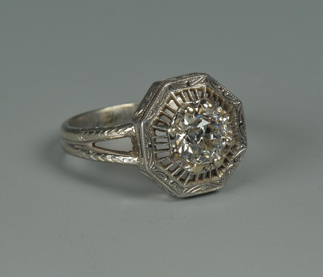 Lot 68: European cut diamond solitaire w/ dia band