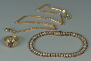 Lot 71: 14K ring, 14K watch chain, 10K dia bracelet
