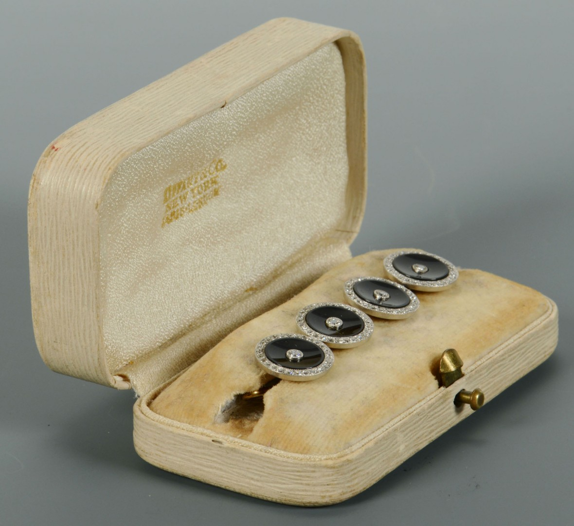 Lot 116: 4 onyx and gold Dress Studs, retailed by Tiffany
