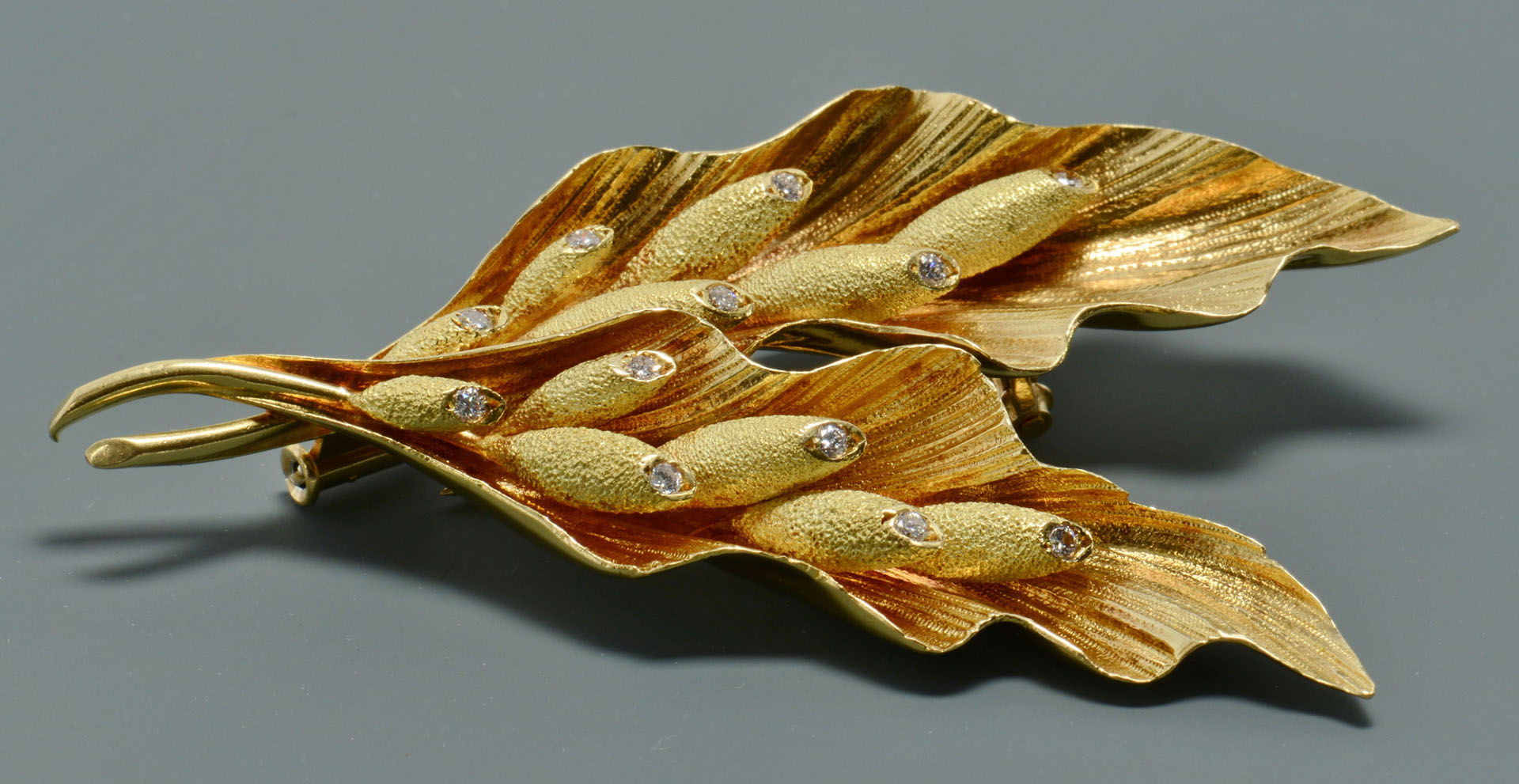 Lot 117: 18K Diamond French Leaf Spray Fur Pin