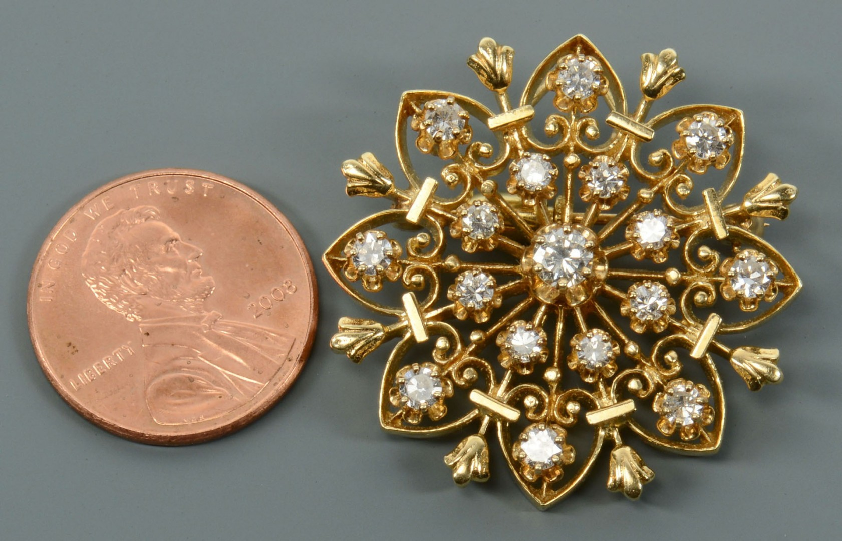 Lot 118: 14k Gold and Diamond Starburst Pin