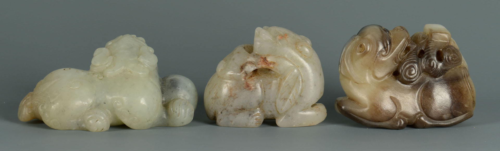 Lot 12: Group of 3 Celadon Jade Foo Dogs