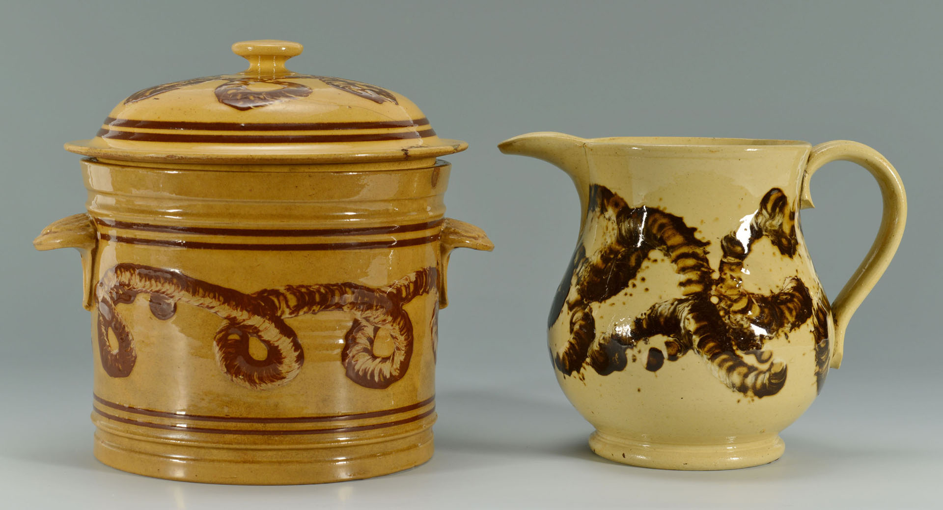 Lot 144: Yellowware Mocha Earthworm jar and pitcher