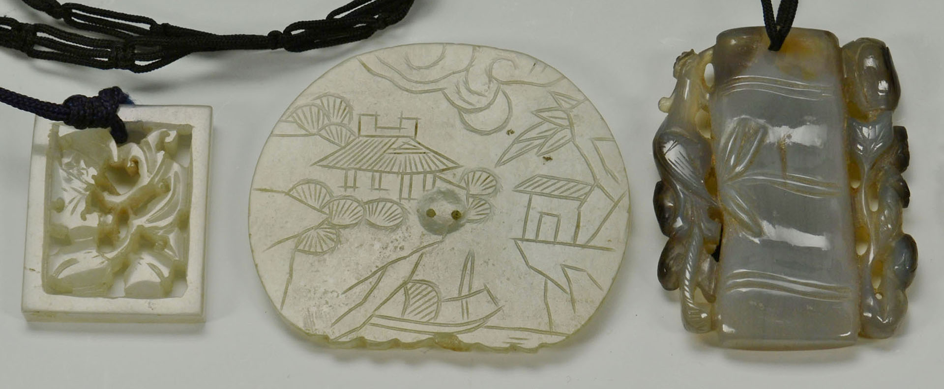 Three Chinese Jade Plaque Pendants plus other