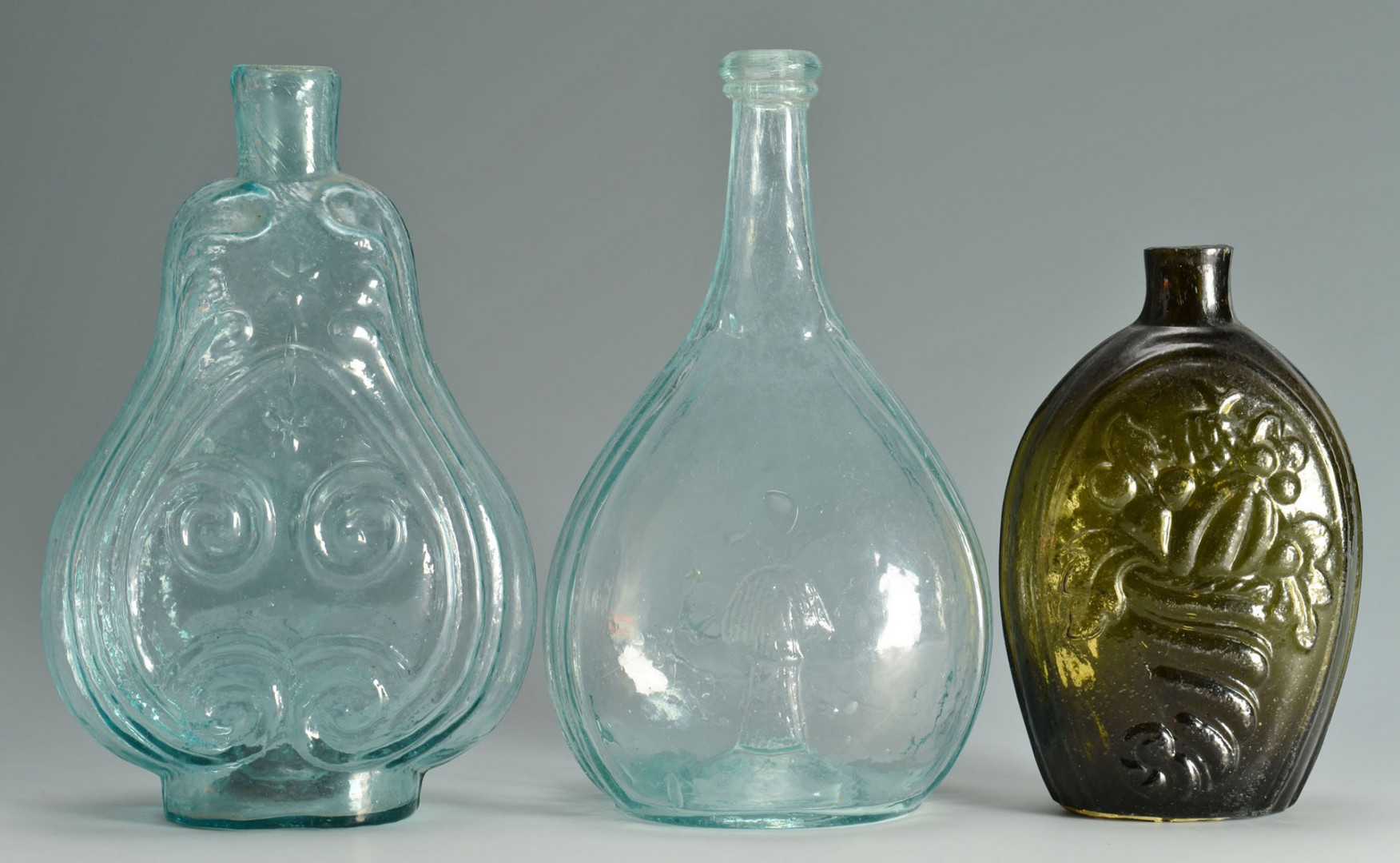 Lot 152: 3 Blown Mold Flasks with Various Designs