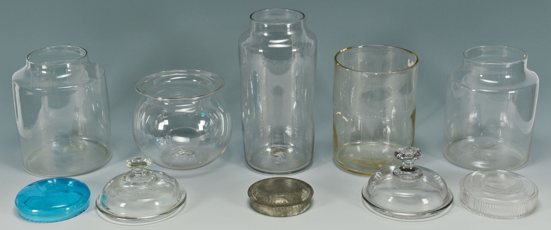 Lot 156: 9 Early Glass Canister Jars with tin and glass lid