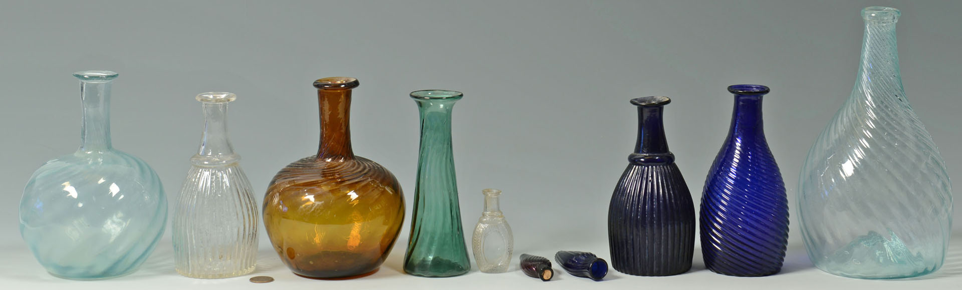 10 blown colored glass bottles, many pitkin type