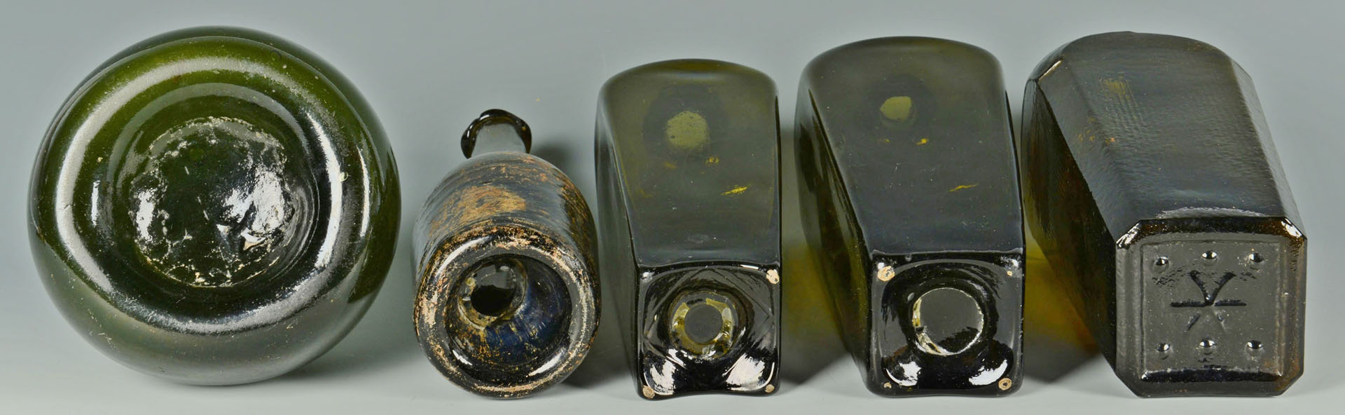 Lot 159: 5 Colored wine & gin bottles, 18th/19th c.