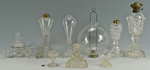 Lot 283: 9 Colorless blown and molded glass oil lamps
