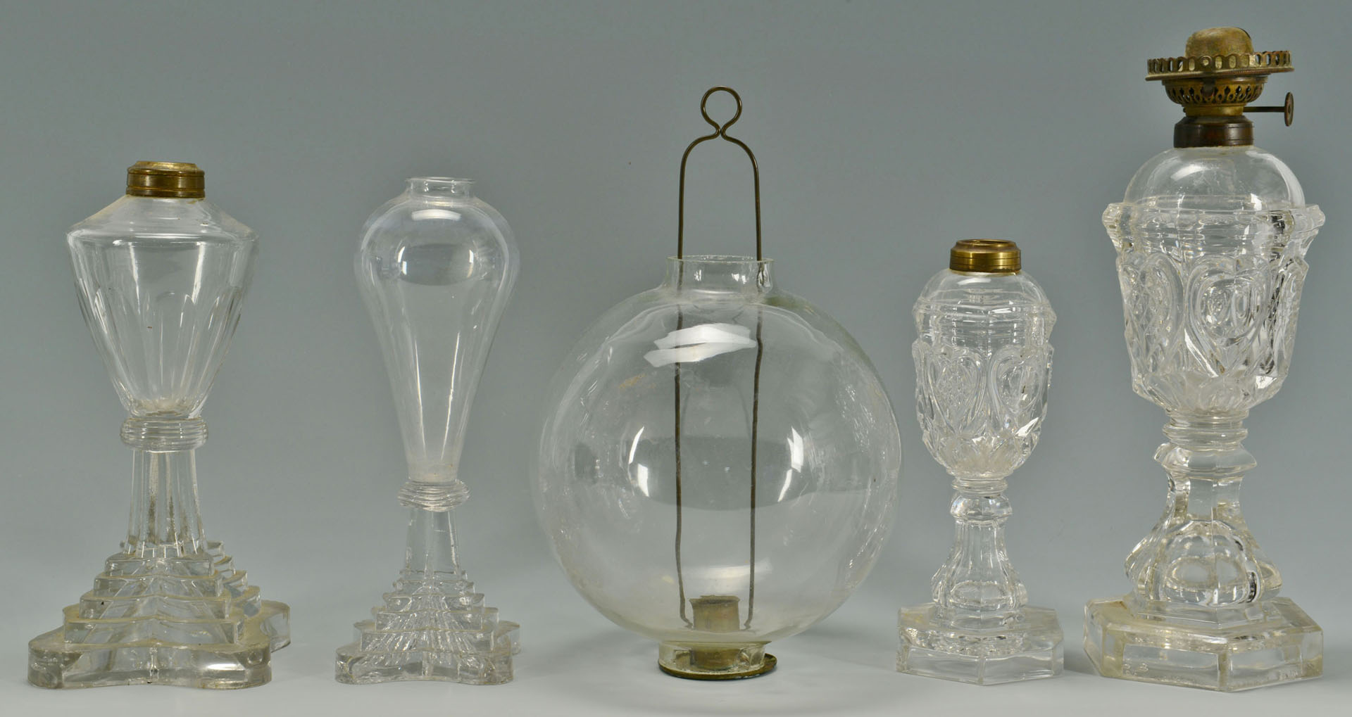 9 Colorless blown and molded glass oil lamps