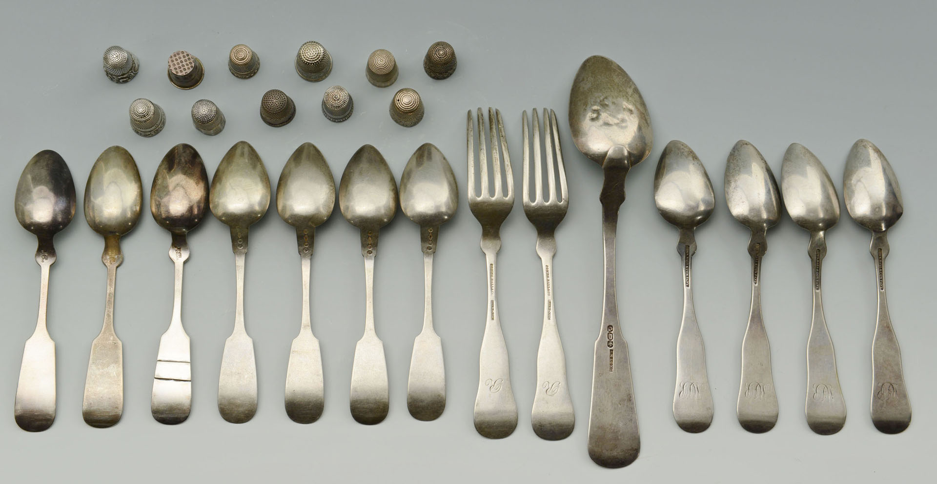 14 pcs. coin and sterling silver flatware & 11 thi