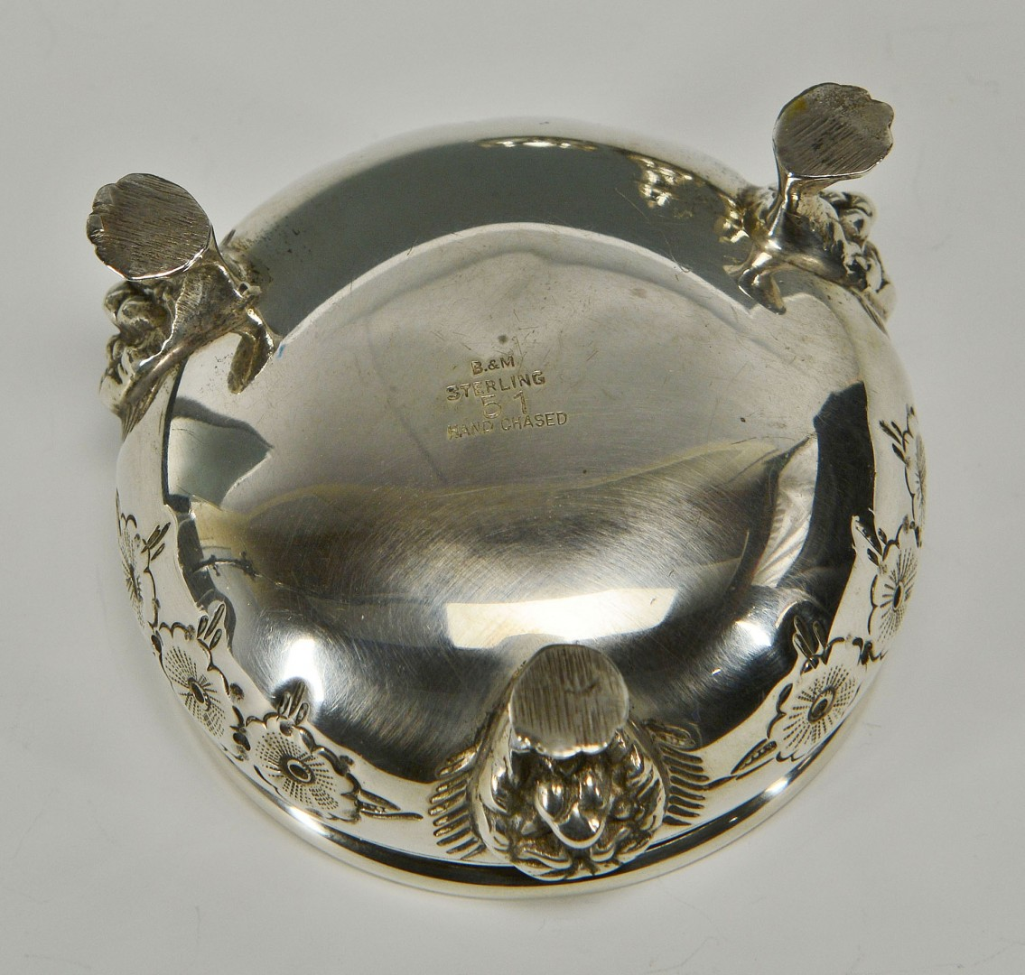 Lot 295: Hand chased sterling silver salts and peppers
