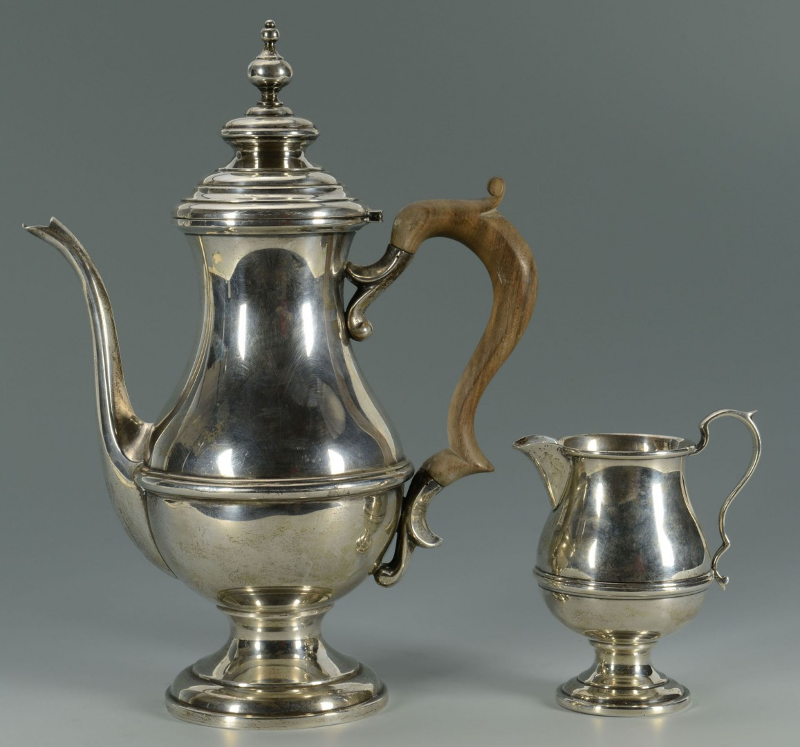 Lot 298: Sterling silver teapot and creamer, George III Sty