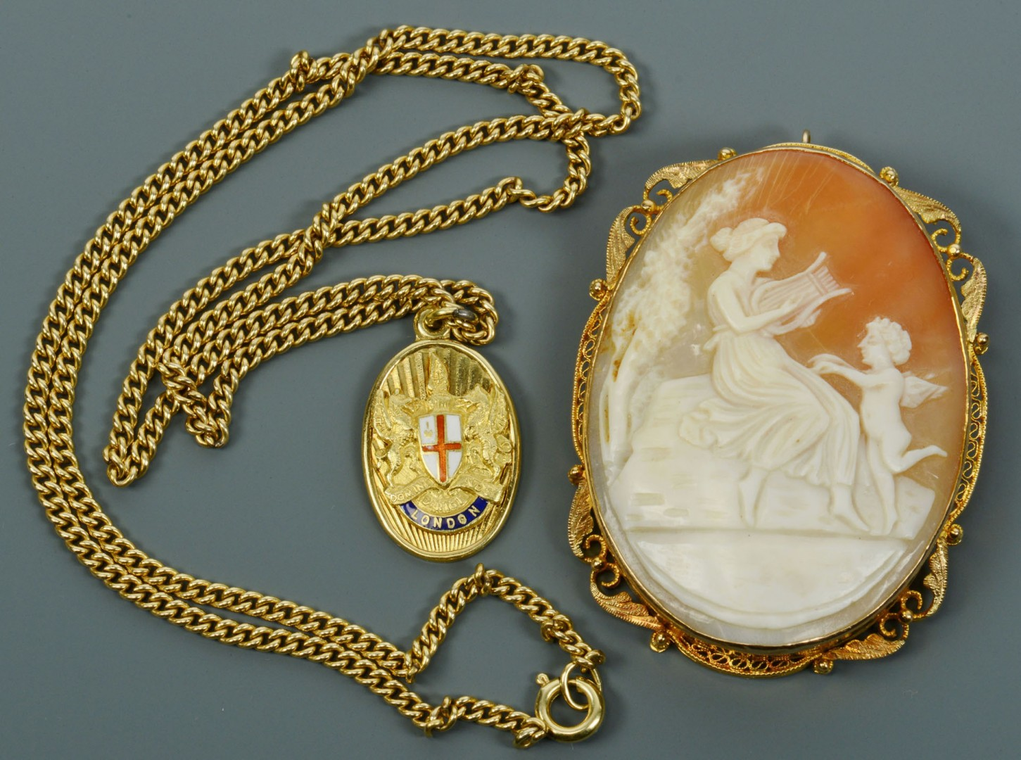 Lot 315: 18k London pendant and GF Cameo