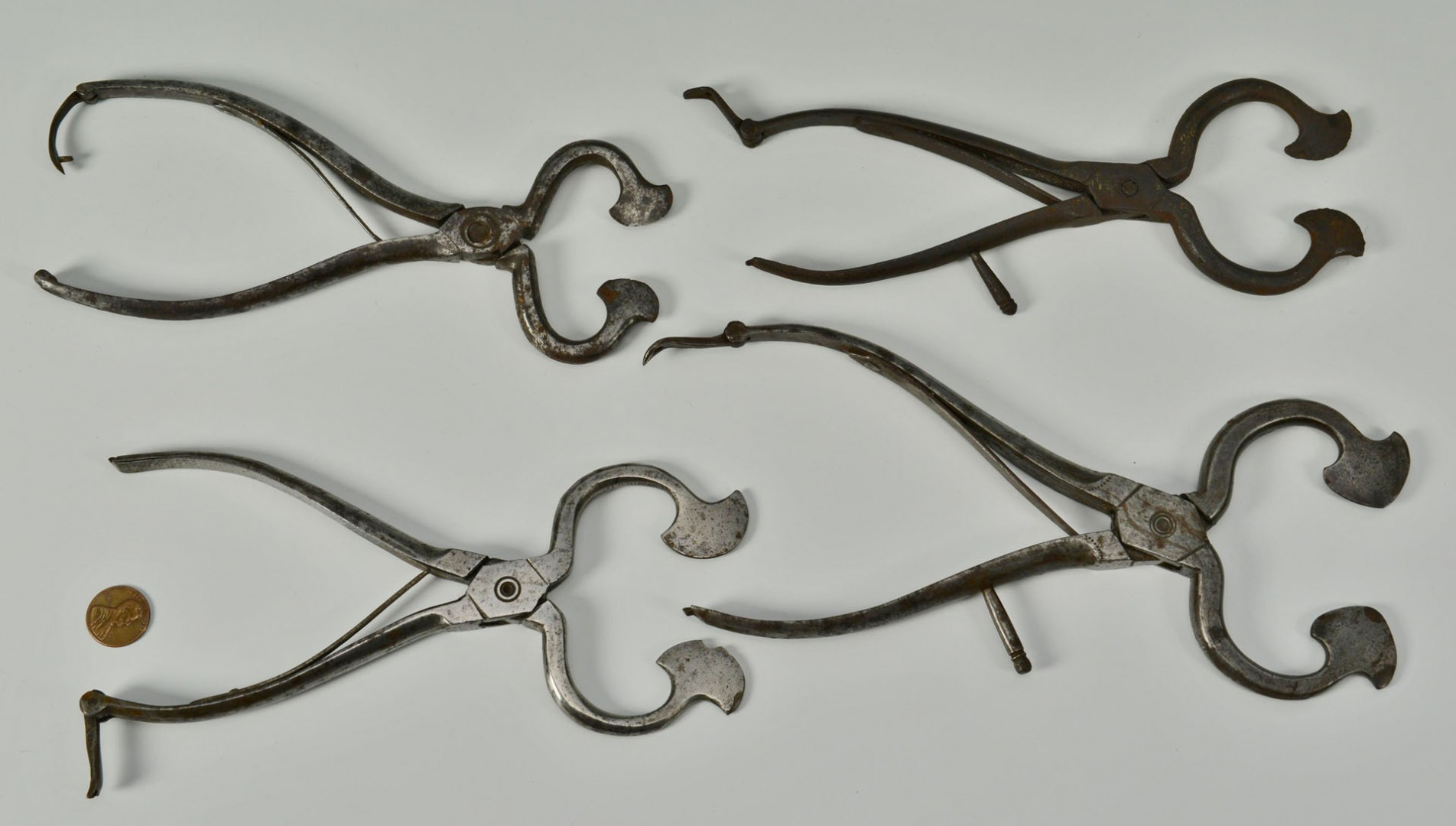 Lot 325: Grouping of 4 early iron sugar nips, some engraved