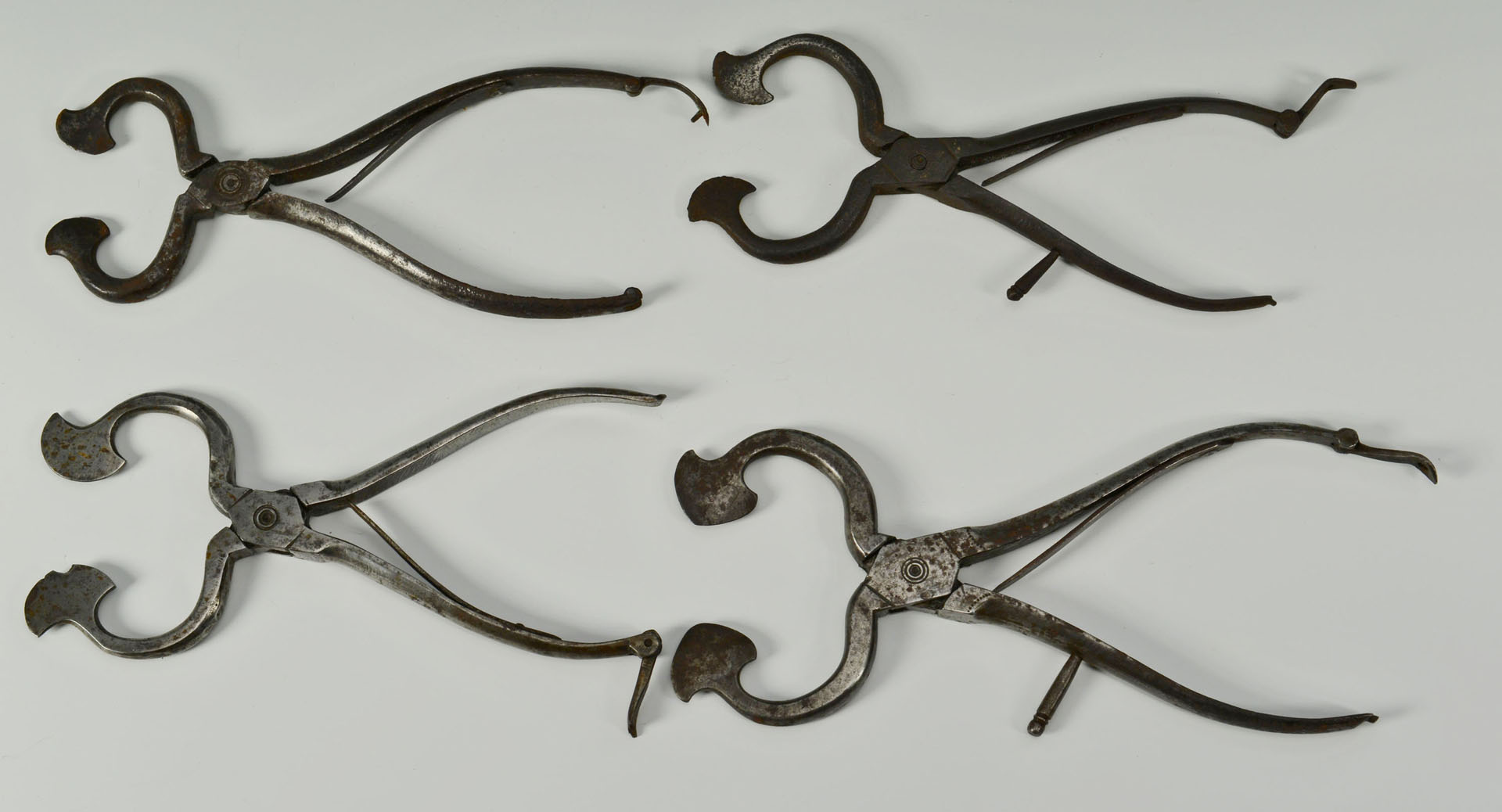 Grouping of 4 early iron sugar nips, some engraved