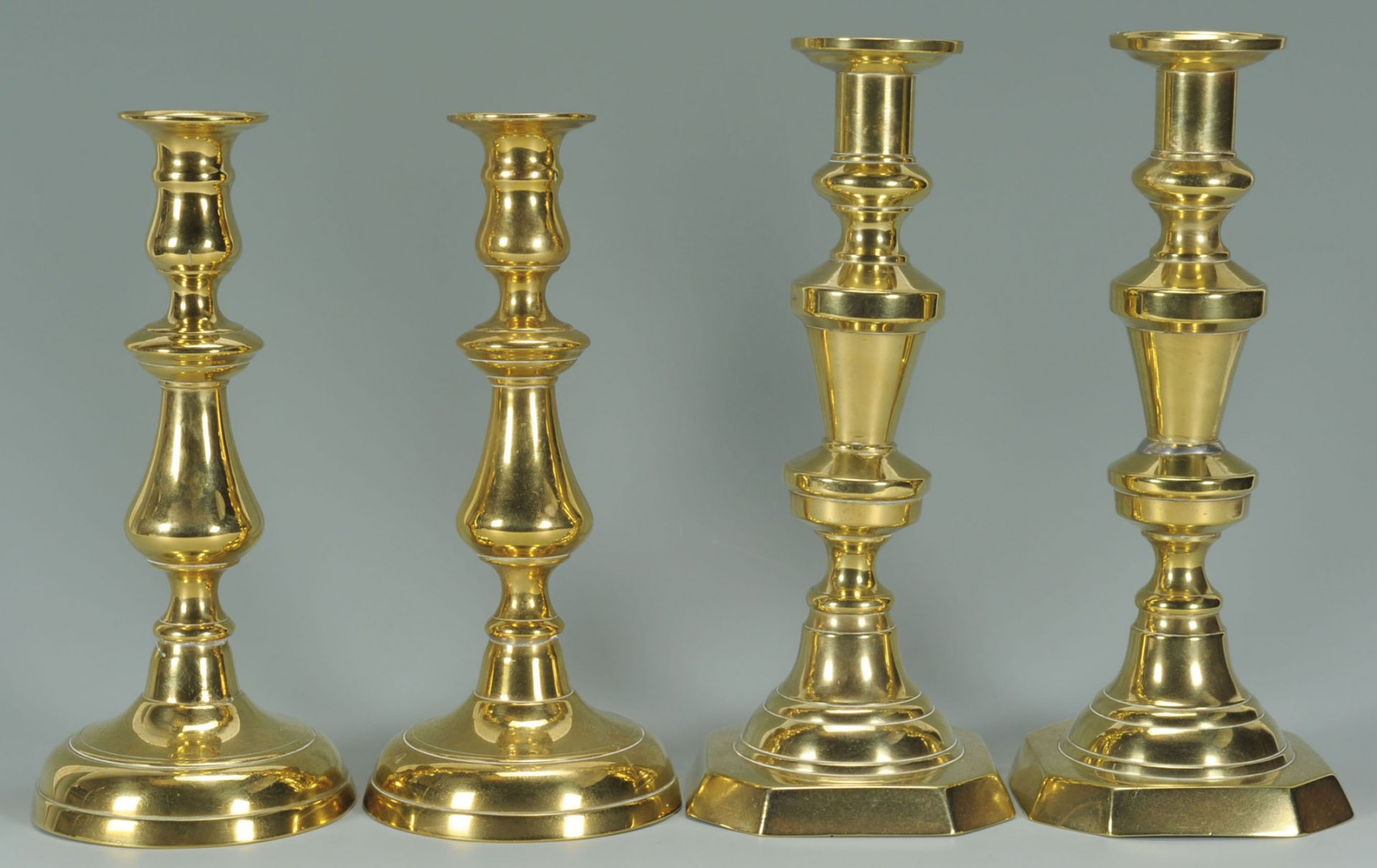 Lot 425: 4 Pairs Brass Candlesticks, 1 with shades, 8 total