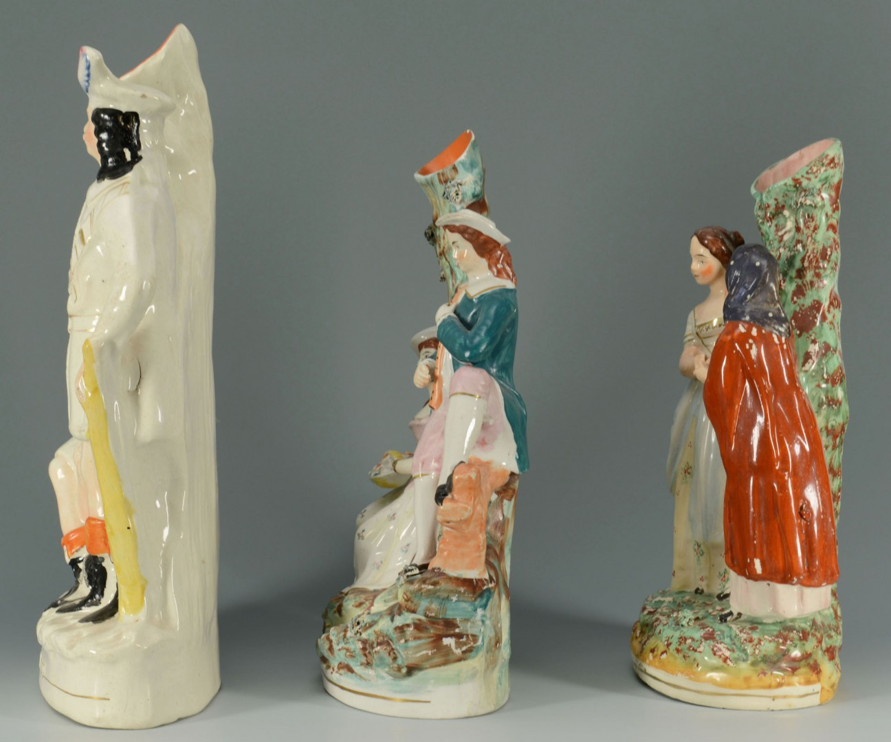 Lot 437: 3 Staffordshire Spill Vase Figural scenes