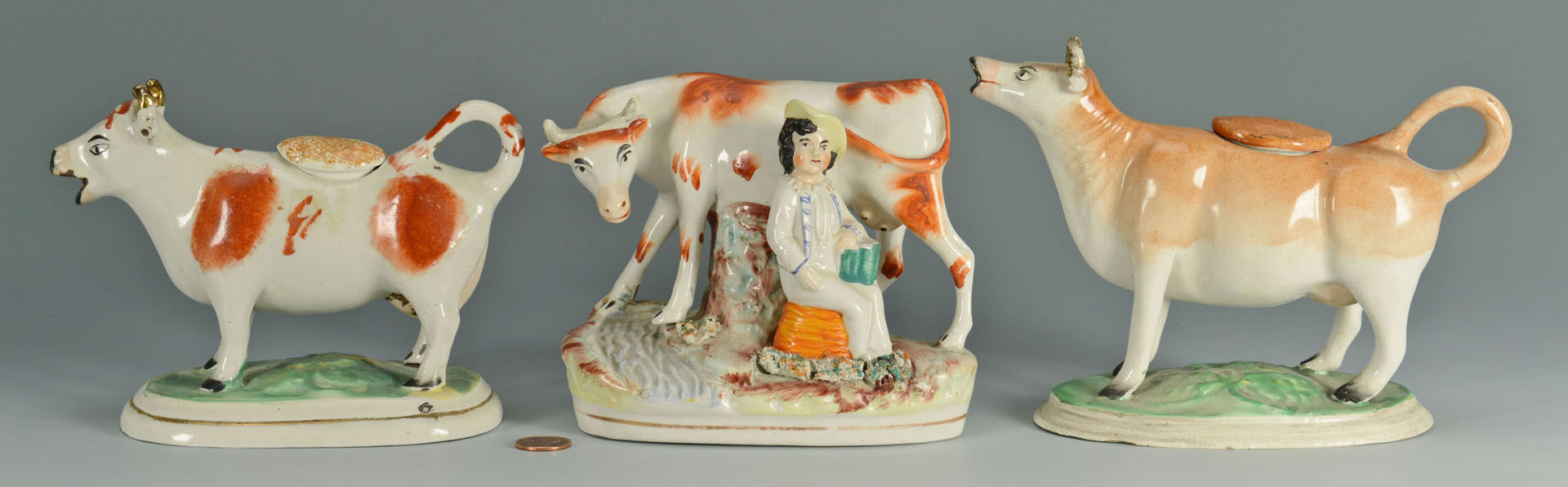 Lot 438: 3 Staffordshire Pottery Cows