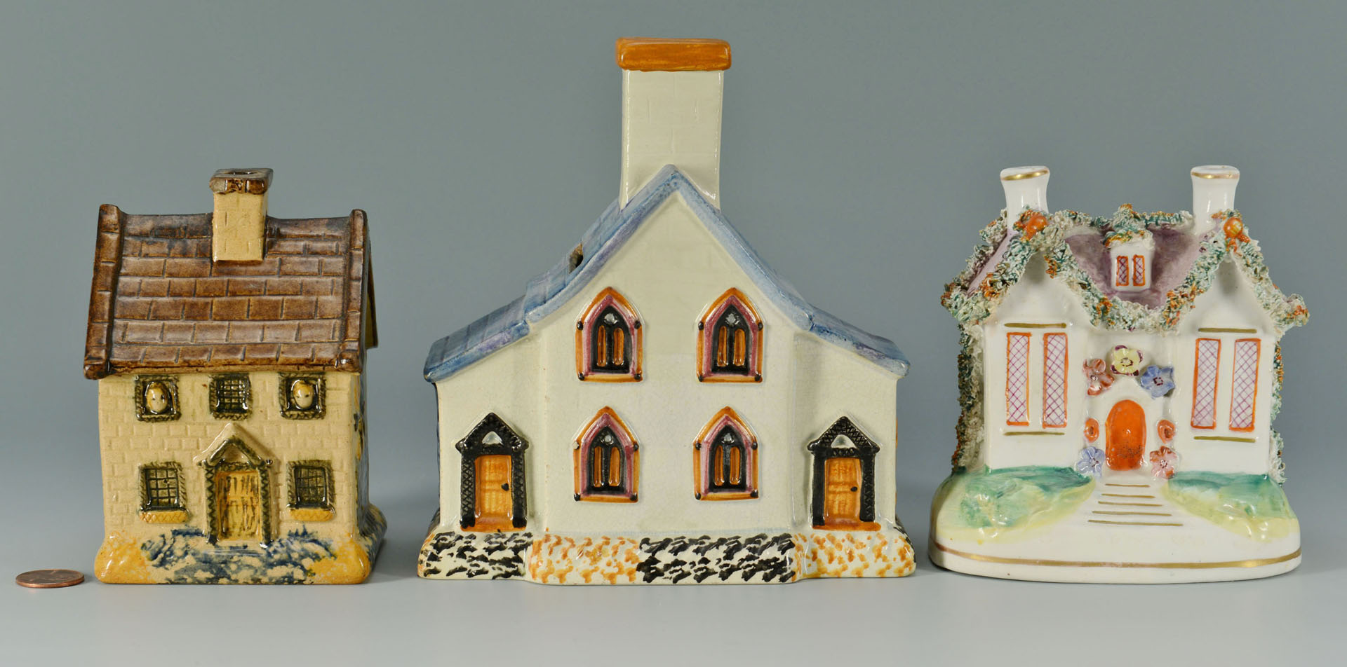 Lot 443: 3 Staffordshire Money Box Cottages