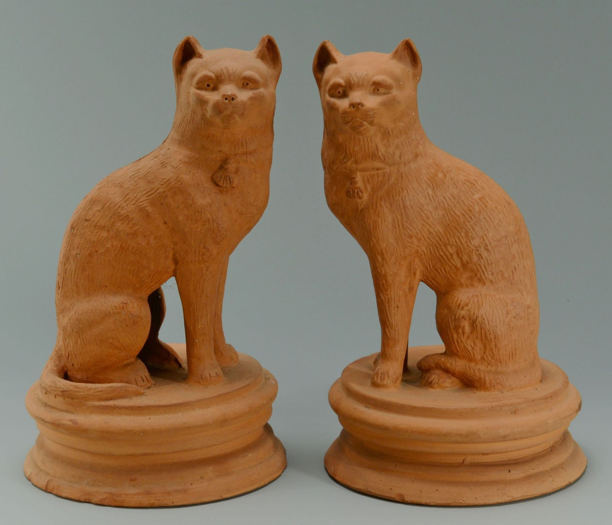 Lot 462: Pair of Terra Cotta Cats and 2 Cow Creamers
