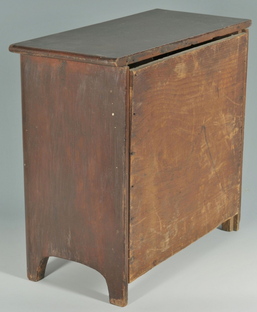 Lot 463: Miniature three-drawer chest