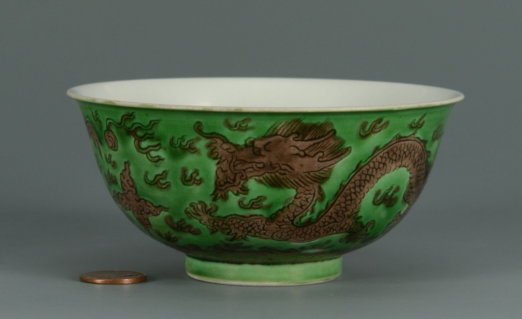 Lot 479: Chinese Porcelain Bowl w/ Green Ground & Dragon