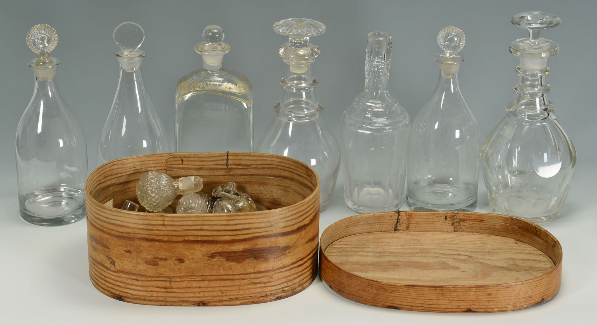 Lot 530: 7 early Glass Decanters plus 29 stoppers