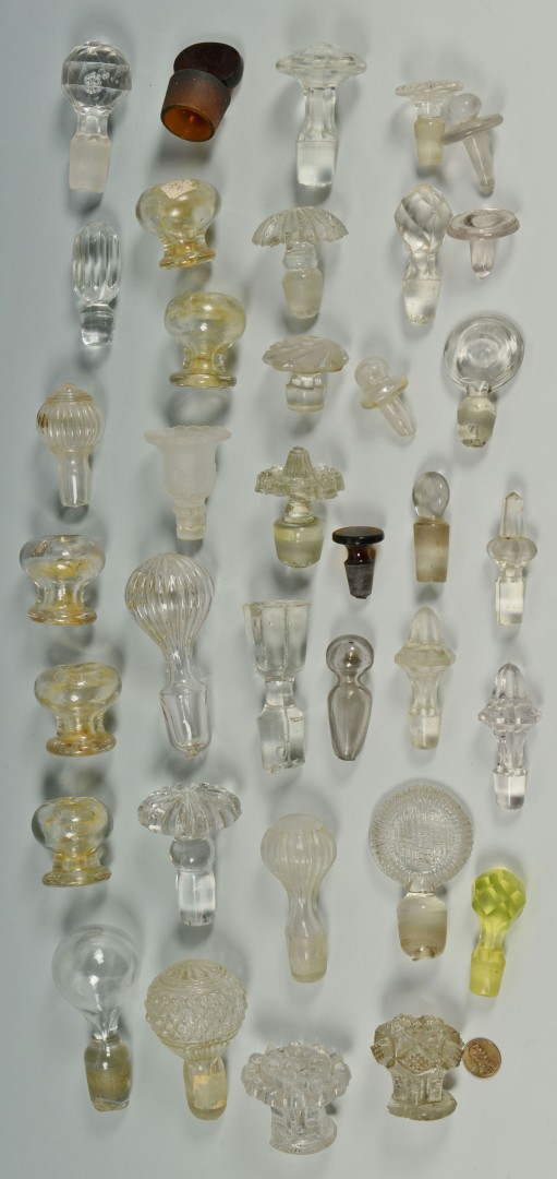7 early Glass Decanters plus 29 stoppers