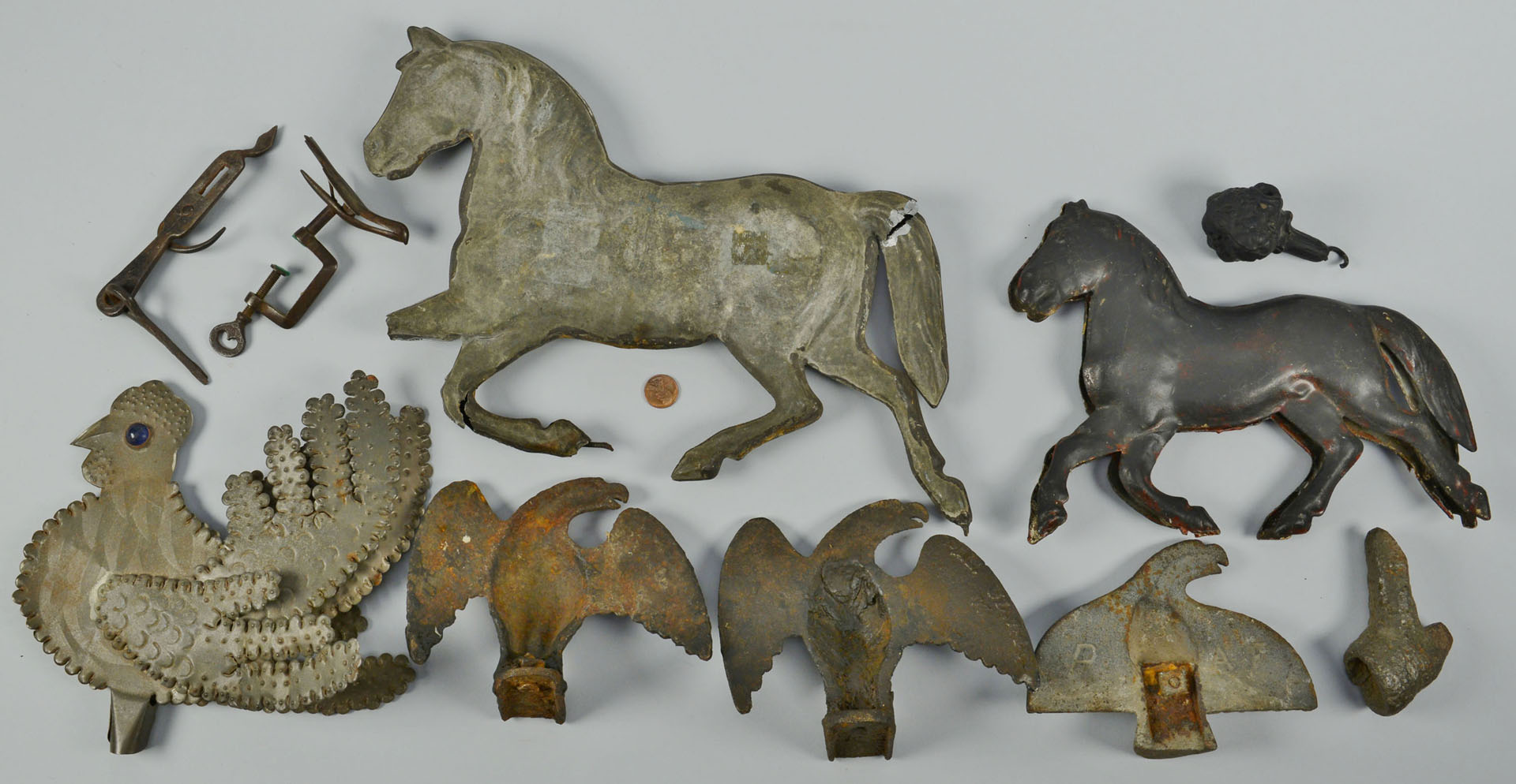10 iron and tin animal related items, 19th c.