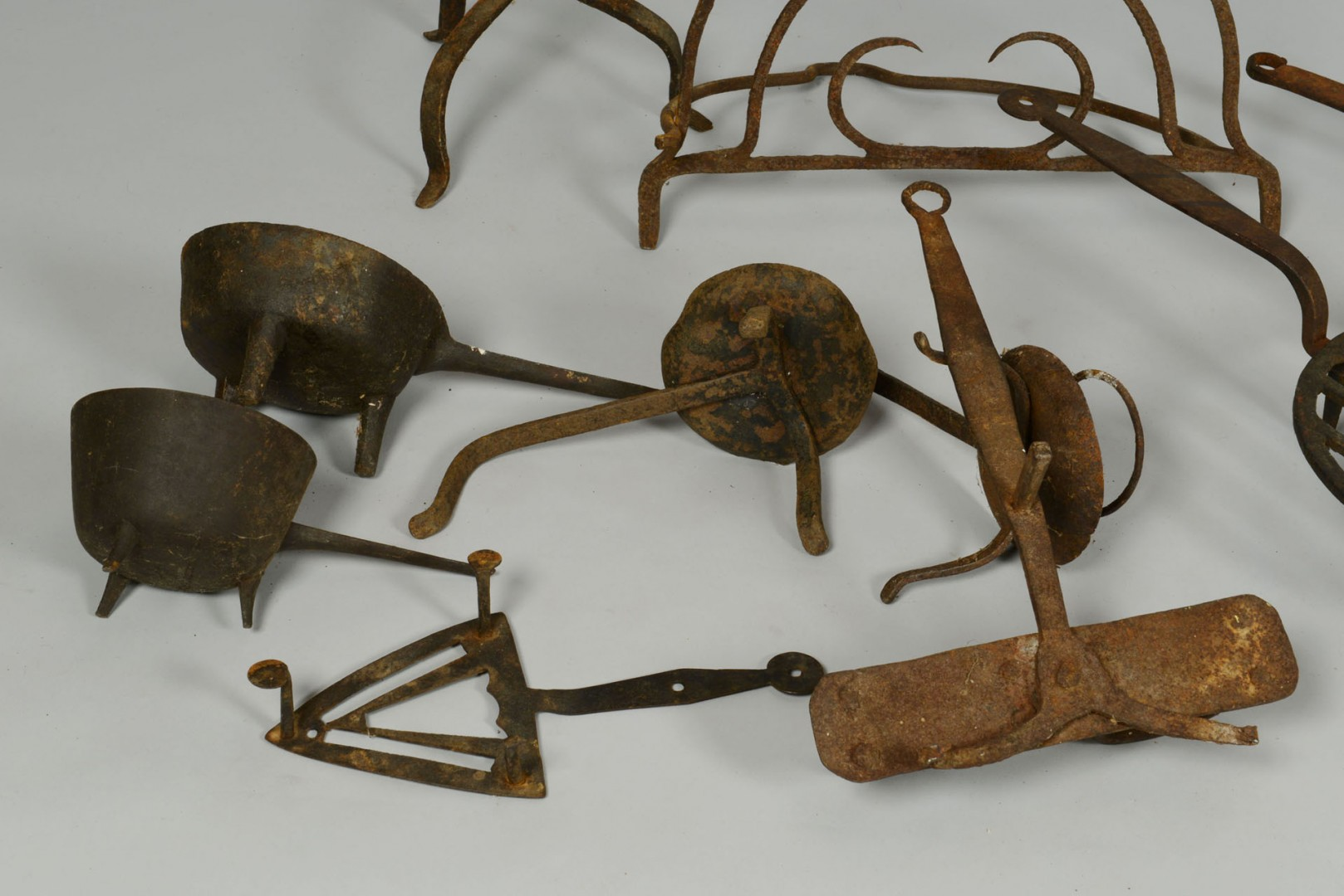 Grouping of early wrought iron hearth items, 10