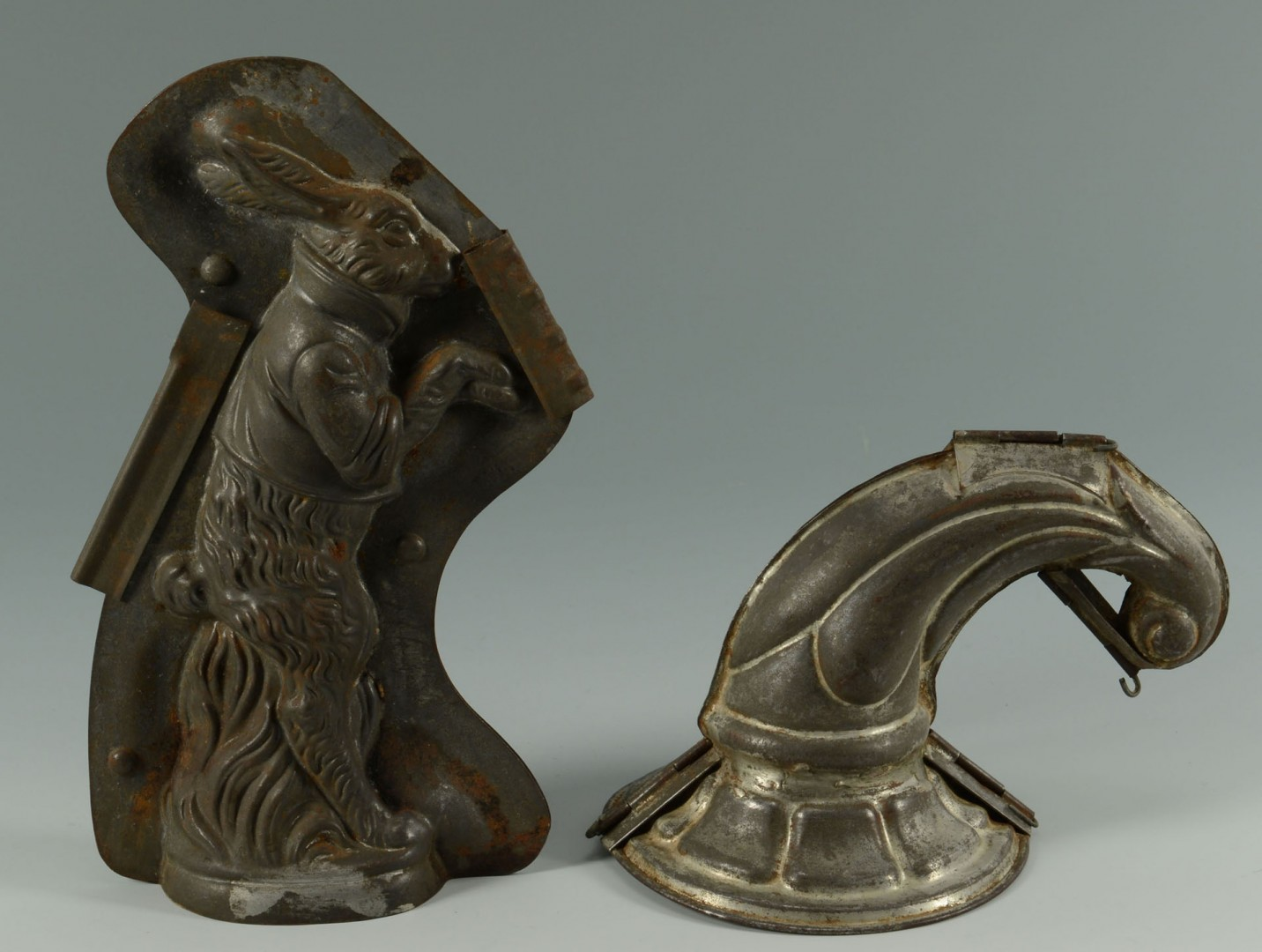 Lot 543: Early Tin Chocolate Molds and Large Cookie Cutters