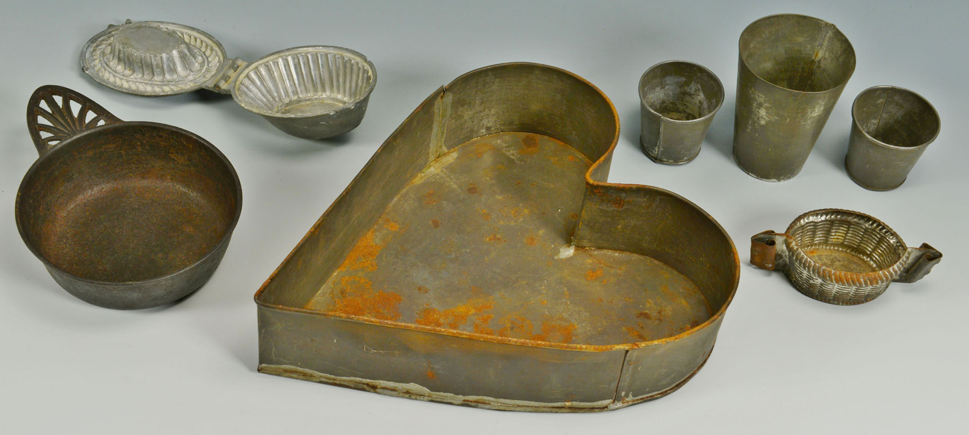 Lot 544: Group of Tin Cookie Cutters, Molds, Porringer