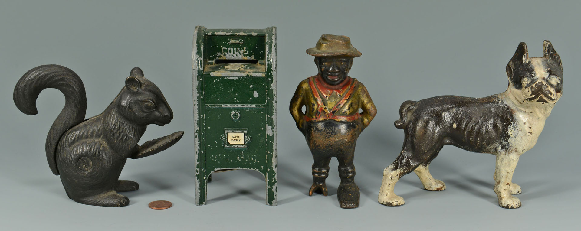 Four cast iron figural items inc. banks