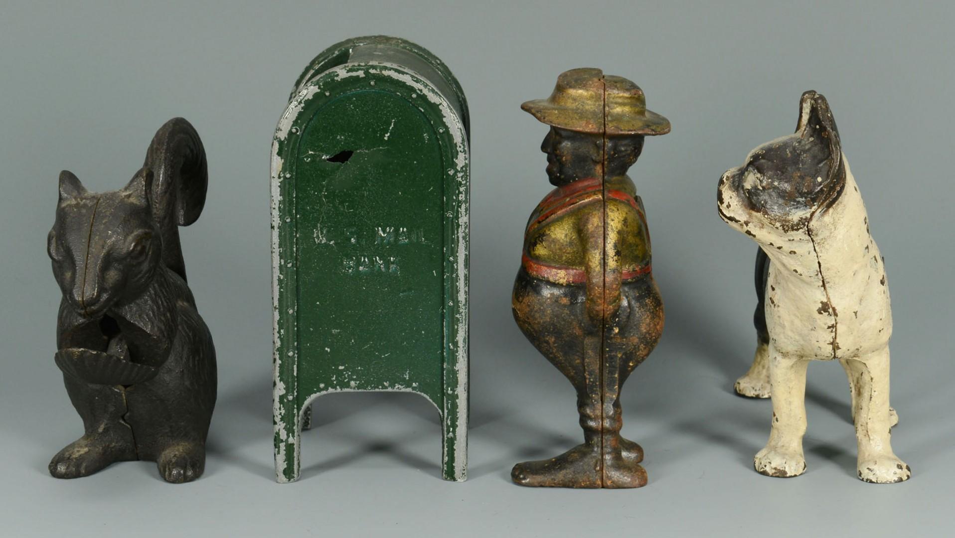Lot 587: Four cast iron figural items inc. banks