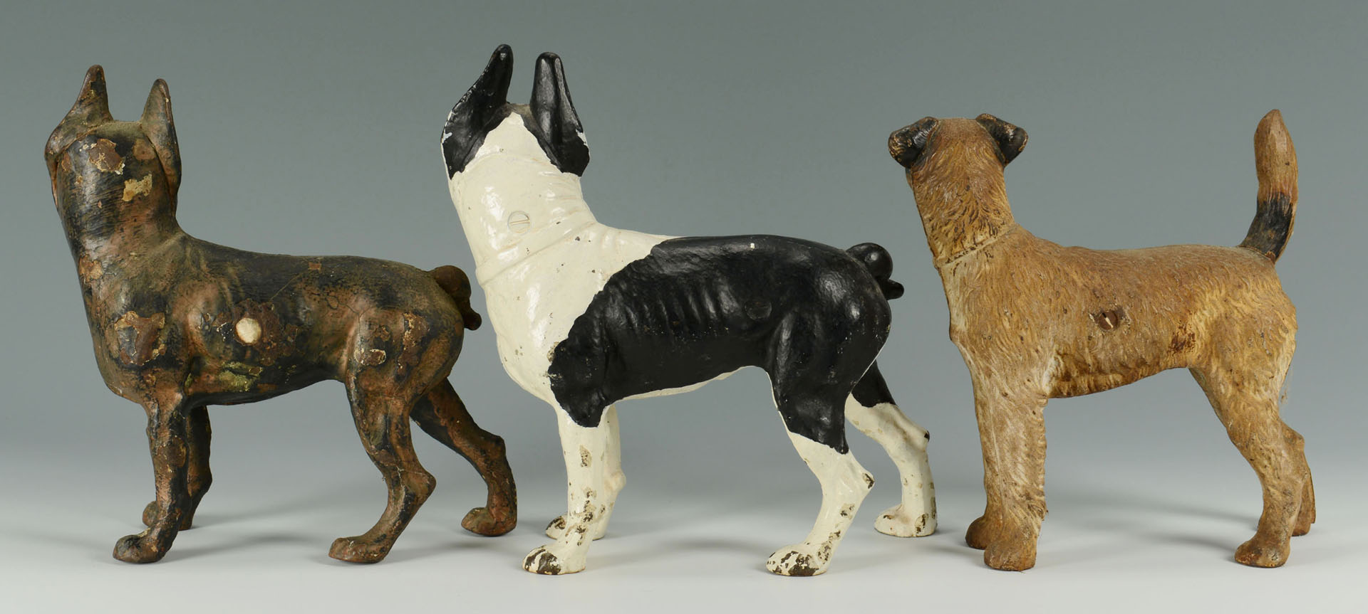 Lot 589: 3 Cast Iron Dog Doorstops