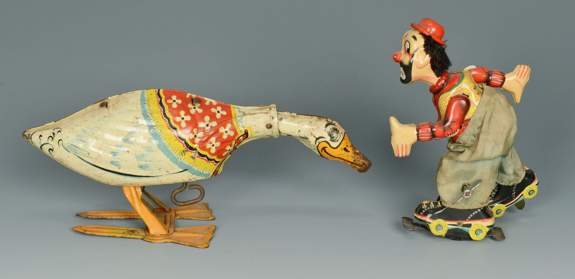Lot 591: 4 Lithographed Tin Toys
