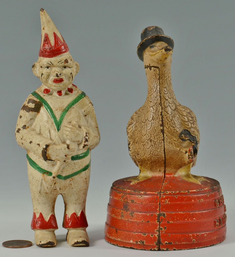 Lot 592: 2 Cast Iron still banks: Clown and Duck