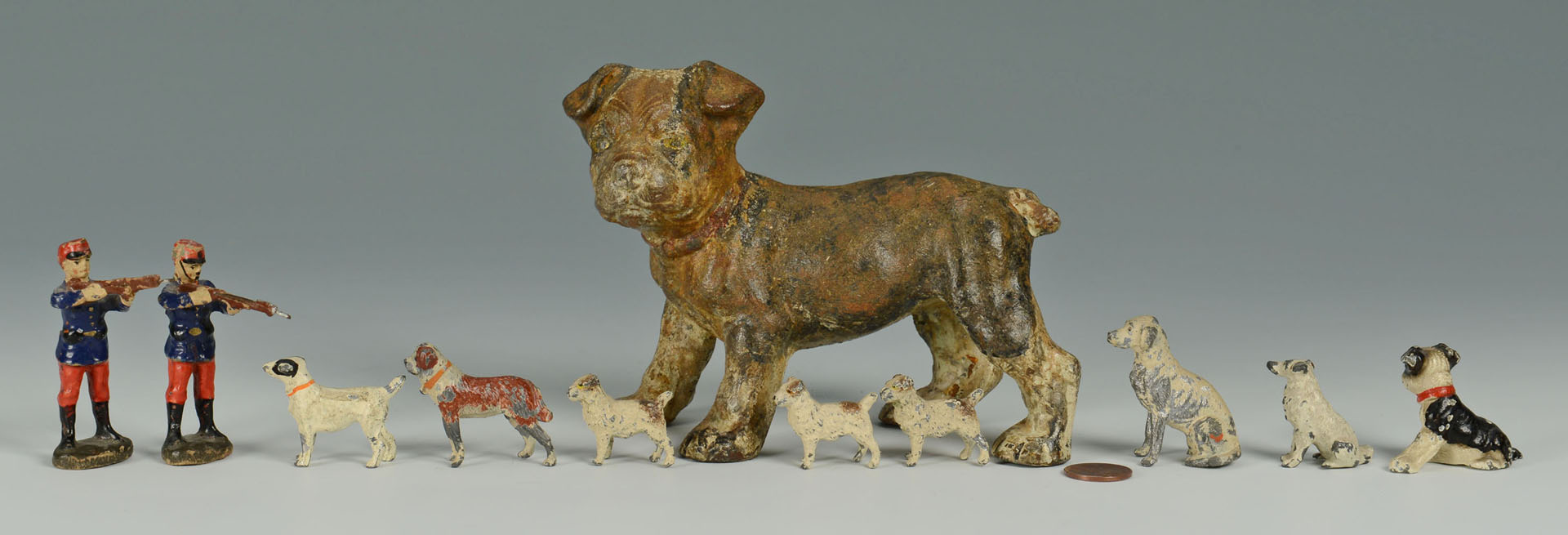Lot 593: Grouping of Miniature Metal Toy Soldiers and dogs